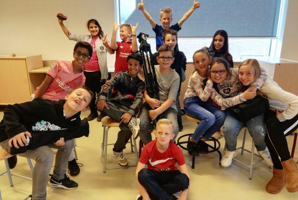 Films over Waterkwartier in première op basisschool Aquamarijn: Kinderen uit Waterkwartier verfilmen verhalen van hun wijk